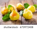 fresh pears with leaves on... | Shutterstock . vector #673972408