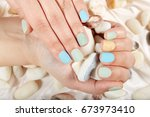 hands with short matte... | Shutterstock . vector #673973410