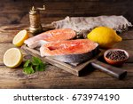 fresh salmon steaks with... | Shutterstock . vector #673974190