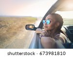 trendy girl traveling by car | Shutterstock . vector #673981810