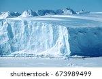 Antarctica, Weddell Sea, Riiser Larsen Ice Shelf, Iceberg with Emperor Penguins