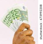 hand holding money  euro money. | Shutterstock . vector #673992208