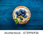 delicious blueberry tartlets...   Shutterstock . vector #673996936
