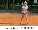 young woman playing tennis | Shutterstock . vector #674000380