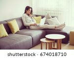 young woman in living room... | Shutterstock . vector #674018710