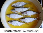 small whole fishes lounged in... | Shutterstock . vector #674021854