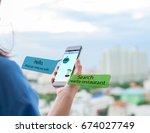 chatbot concept.female hands... | Shutterstock . vector #674027749