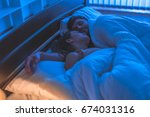 the sleeping couple relax in... | Shutterstock . vector #674031316