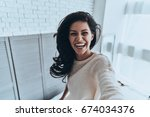 sincere smile. self portrait of ... | Shutterstock . vector #674034376
