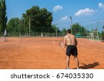 men playing tennis. man is... | Shutterstock . vector #674035330
