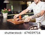 chef leaning on the counter... | Shutterstock . vector #674039716