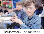 young boy working with fret saw....   Shutterstock . vector #674043970