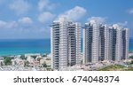 tall buildings on sea side | Shutterstock . vector #674048374