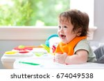 happy little baby boy with a... | Shutterstock . vector #674049538
