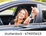young woman getting her key in... | Shutterstock . vector #674055613