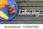 Small photo of Happy Labor Day Typography Over Wood Background with Grilled Food
