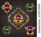 set of golden royal shields... | Shutterstock .eps vector #674070040