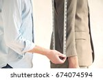 midsection of young male tailor ... | Shutterstock . vector #674074594