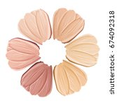 Stock photo smears of foundation for face conceptual flower from concealer smears isolated on white background 674092318
