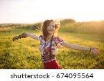 girl enjoying nature on the... | Shutterstock . vector #674095564