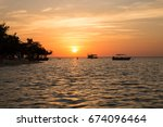 Small photo of Sunset at Tapajos river in Alter do Chao - Para - Brazil