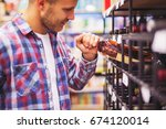 young man choosing and buying... | Shutterstock . vector #674120014
