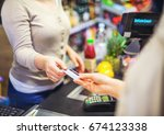 woman paying with a credit card ...   Shutterstock . vector #674123338
