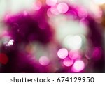 Small photo of Bokeh purple texture with lighting pellucid circles