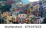 colorful buildings of manarola... | Shutterstock . vector #674147623