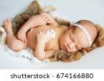 newborn baby girl sleeping. | Shutterstock . vector #674166880