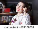 smiling young woman using a... | Shutterstock . vector #674180854