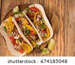 three mexican carnitas tacos... | Shutterstock . vector #674185048