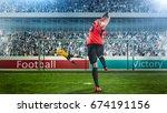 Female Soccer Player Taking...