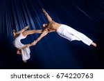 couple circus air gymnast on... | Shutterstock . vector #674220763