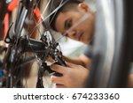 repair technician bicycles was... | Shutterstock . vector #674233360