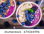 purple smoothie bowl with fresh ... | Shutterstock . vector #674264596