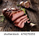 smoked ham sliced on a wooden...   Shutterstock . vector #674270353