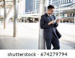 asian business man using tablet | Shutterstock . vector #674279794