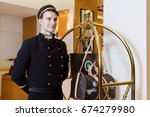 Young Man In Uniform Serving I...