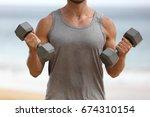 fitness man training biceps