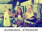 two young glad women picking... | Shutterstock . vector #674316130