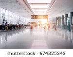 people in airport terminal... | Shutterstock . vector #674325343