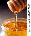 honey dripping from honey... | Shutterstock . vector #674326063