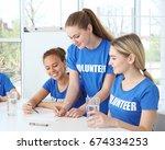 meeting of young volunteers... | Shutterstock . vector #674334253