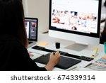graphic designer woman working...   Shutterstock . vector #674339314