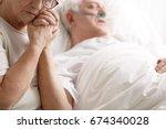dying senior man in hospital... | Shutterstock . vector #674340028