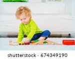 cute 3 year old boy is playing... | Shutterstock . vector #674349190