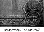 ancient knob on wooden door in ...