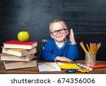 happy cute clever boy is... | Shutterstock . vector #674356006
