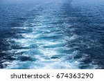 trail on water surface after... | Shutterstock . vector #674363290
